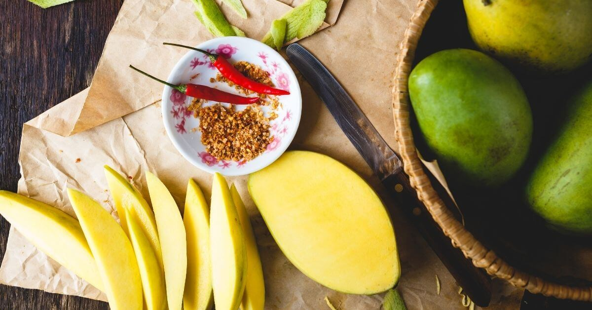green mangoes and fruit table