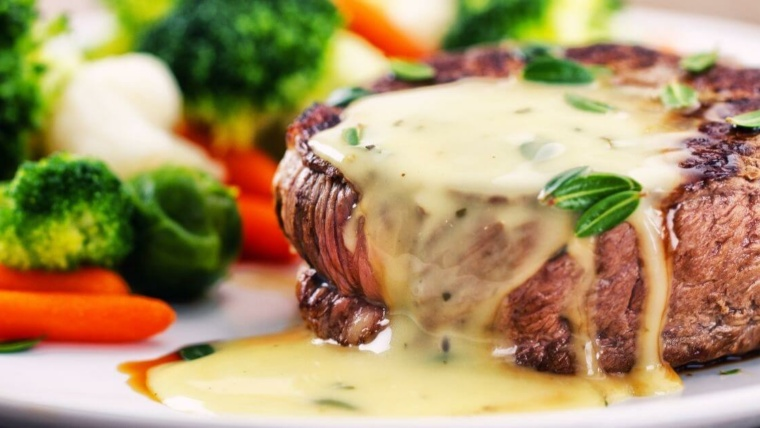 steak topped with bearnaise sauce