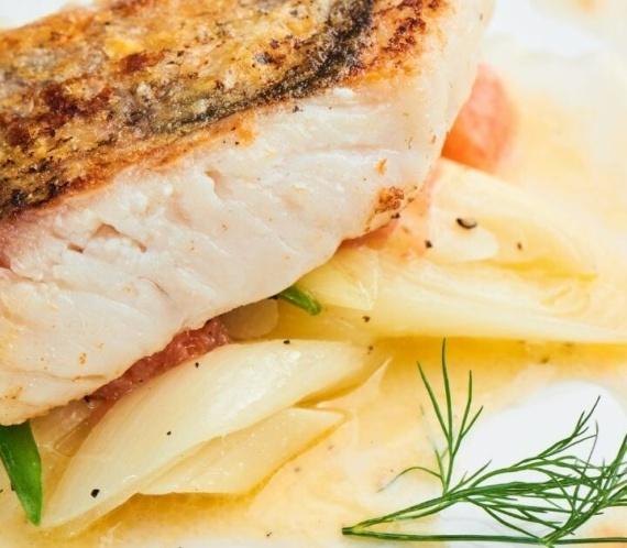 fried fish with spices and beurre blanc sauce