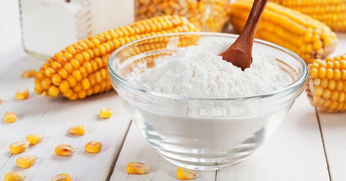 cornstarch on a bowl and cobs of corn